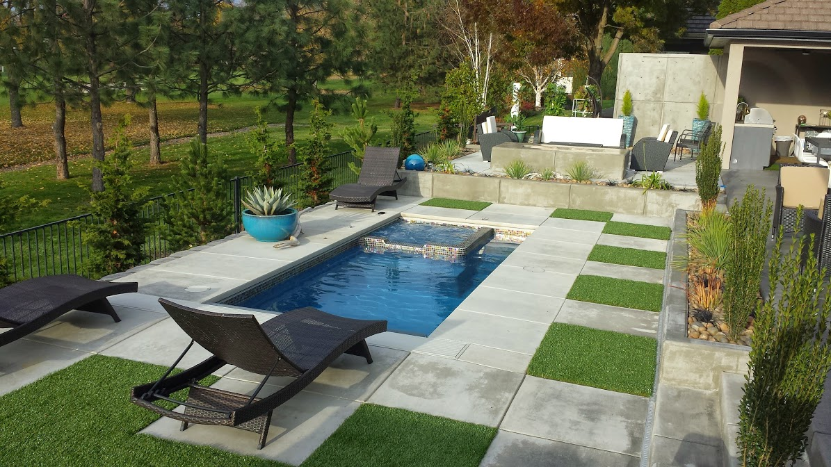 Custom swimming pool and outdoor space by A Plus Pools