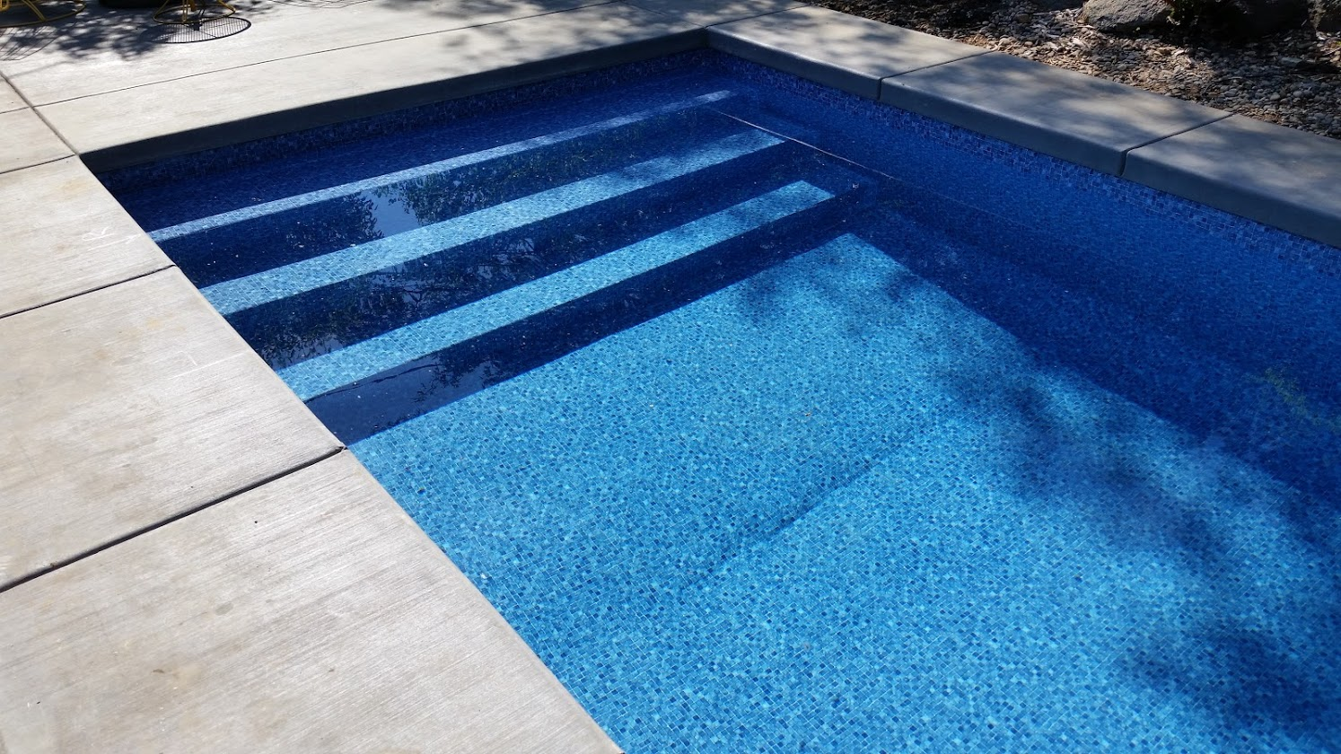 Custom swimming pool and outdoor space pool by A Plus Pools