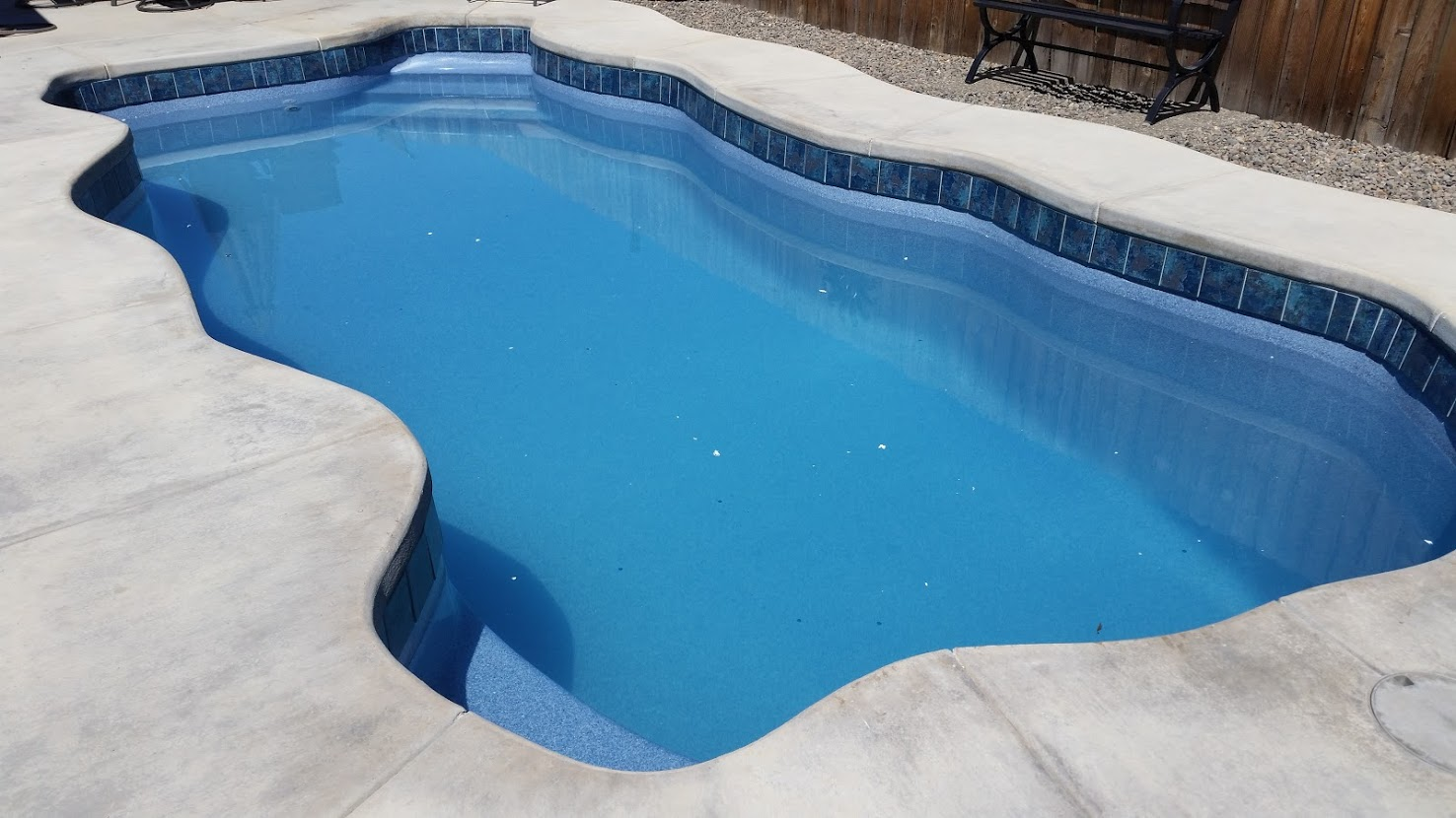 Upgrade to new tile on existing Key West pool by A Plus Pools