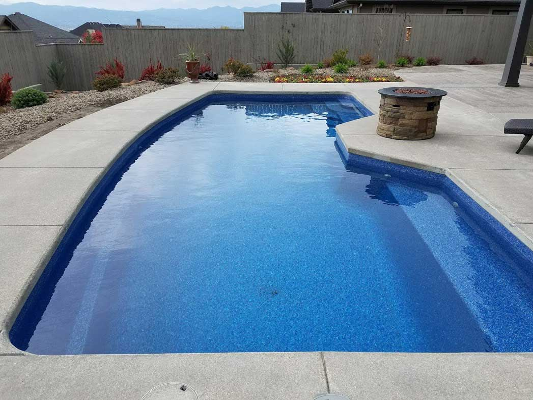 Triton model pool with Pacific Pool Finish by A Plus Pools